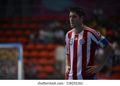 BANGKOK,THAILAND-NOVEMBER 04: Fabio Alcaraz of Paraguay looks dejected during the FIFA Futsal World Cup between Paraguay and Costa Rica at Indoor Stadium Huamark on Nov4, 2012 in Bangkok, Thailand.