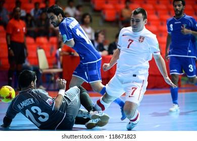 BANGKOK,THAILAND-NOVEMBER 06:Slobodan Janjic (white) of Serbia in actionduring the FIFA Futsal World Cup between Kuwait and Serbia at Indoor Stadium Huamark on Nov6, 2012 in ,Thailand.