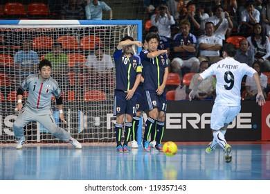 BANGKOK,THAILAND-NOVEMBER 07: Ahamed Fathe (white) of Libya shoot the ball during the FIFA Futsal World Cup between Japan and Libya at Indoor Stadium Huamark on Nov7, 2012 in ,Thailand.