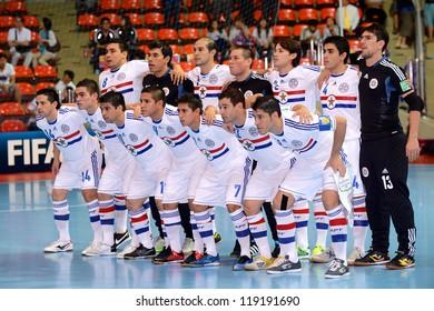 BANGKOK,THAILAND-NOVEMBER 07: Players of Paraguay pose prior to the FIFA Futsal World Cup between Paraguay and Thailand at Indoor Stadium Huamark on Nov7, 2012 in Bangkok, Thailand.