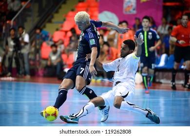 BANGKOK,THAILAND-NOVEMBER 07:Kaoru Morioka (blue) of Japan for the ball during the FIFA Futsal World Cup between Japan and Libya at Indoor Stadium Huamark on Nov7, 2012 in,Thailand.