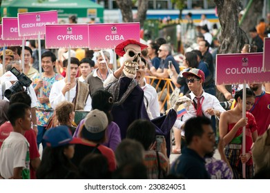 BANGKOK,THAILAND-NOVEMBER 1 : Actors hold and showing their puppets in the parade on Middle Ratchadamnoen road in Harmony World Puppet Carnival on November 1,2014 in Bangkok capital city in Thailand.