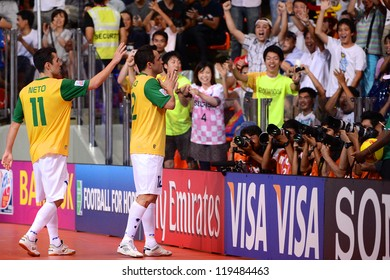 BANGKOK,THAILAND-NOVEMBER 18: Falcao (yellow) of Brazil celebrates scoring during the FIFA Futsal World Cup Final between Spain and Brazil at Indoor Stadium Huamark on Nov18, 2012 in Bangkok,Thailand.