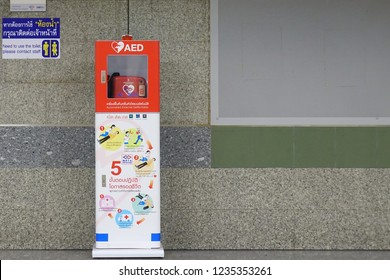 Bangkok,Thailand-November 19 2018:A AED (automated external defibrillator) machine for emergency situation installed on the walkway at  MRT (Metropolitan Rapid Transit) and ready to use.