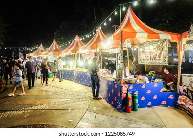 BANGKOK,THAILAND-November 2018-People and Tourist walking, eating, buying food at night street food market festival. Market Stalls. Outdoor Market. Food Event. Food Fair. Festival. Concert. Retail.