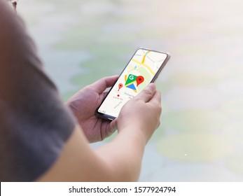 Bangkok,Thailand-November 29,2019-The man watching the screen of his smartphone showing google map app.