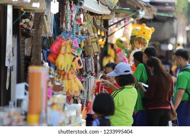 Bangkok/Thailand-November 3,2018. Crowded tourists shopped the local miscellaneous products in the street shop market.