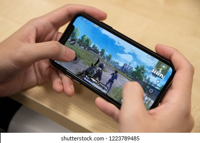 BANGKOK,THAILAND-NOVEMBER 7: Scene of  Hands PlayingPlayer Unknown Battle Ground or PUBG on Iphone on November 7,2018