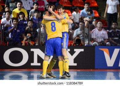 BANGKOK,THAILAND-NOVEMBER04:Maksym Pavlenko(no.7)of Ukraine celebrates after scoring  during the FIFA Futsal World Cup between Thailand and Ukraine at Indoor Stadium Huamark on Nov4, 2012 in,Thailand.