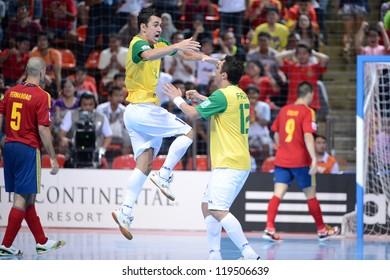 BANGKOK,THAILAND-NOVEMBER18:Neto (no.11) of Brazil celebrates after scoring during the FIFA Futsal World Cup Final between Spain and Brazil at Indoor Stadium Huamark on Nov18, 2012 in,Thailand.