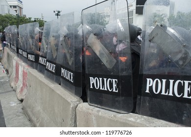 BANGKOK,THAILAND-NOVEMBER,24:Police Commandos guard a barricade on Makkhawan Bridge outside Government HQ on November 24,2012 in Bangkok, Thailand.