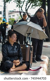 BANGKOK,THAILAND-)OCTOBER 25: An unidentified woman sads at the roadside at the royal funeral on the OCTOBER 25,2017 in Bangkok,Thailand