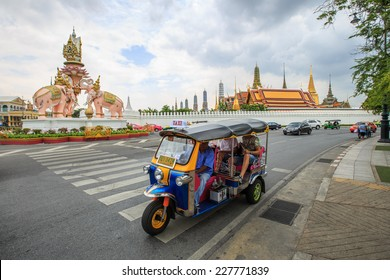 BANGKOK,THAILAND-SEP 11: Tourists take tuk-tuk for convenience sightseeing on SEPTEMBER 11,2014 in Bangkok, Thailand.