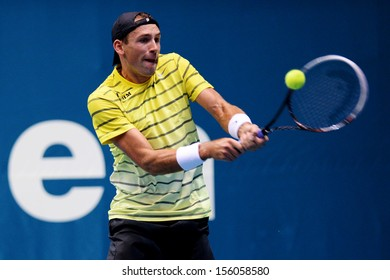 BANGKOK,THAILAND-SEP 24:Lukasz Kubot of Poland returns a shot during match against Lukas Rosol of Czech Republic  at Thailand Open on September24, 2013 at Impact Arena,Bangkok,Thailand