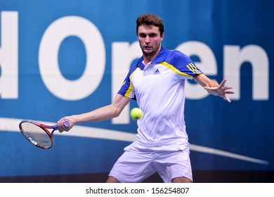 BANGKOK,THAILAND-SEP 26:Gilles SIMON of France returns a shot during match against Bernard Tomic of Australia at Thailand Open 2013 on September26, 2013 at Impact Arena , Bangkok,Thailand