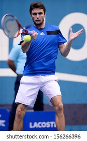 BANGKOK,THAILAND-SEP 28:Gilles Simon of France returns a shot during match against Tomas Berdych of Czech Republic at Thailand Open 2013 on September28, 2013 at Impact Arena,Bangkok,Thailand