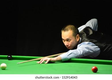BANGKOK,THAILAND-SEP 3,2013: James Wattana player of Thailand in action during Snooker 6-Red World Championship 2013 at Montien Riverside? hotel on September 3,2013 in Bangkok, Thailand