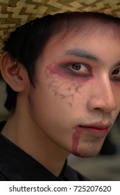 BANGKOK,THAILAND-SEPTEMBER  23: unidentified Asian teenage boy in ghost art style with creative makeup,drop on her face for a Halloween day contest at a university, On Sep 23,2017 in Bangkok, Thailand