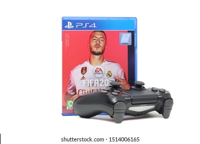 BANGKOK,THAILAND-SEPTEMBER 26: The New  PS4  FIFA Football 2020 game with Joystick on September 26,2019