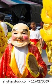 BANGKOK,THAILAND-SEPTEMBER 30 2016: Chinese lion dance at Yaowarat or Bangkok Chinatown street during chinese vegetarian festival in Thailand 2016.