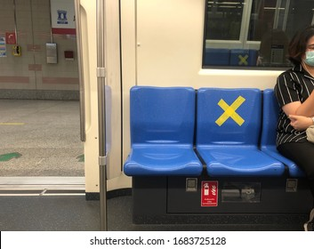 BANGKOK/THAILAN-Mar 26, 2020: Social distancing inside a MRT subway train. Yellow cross symbol on a seat means one shall not sit there. Infection control.