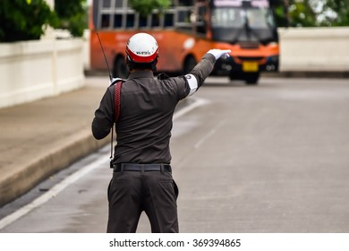 Bangkok,Thaland - August 2,2015: Thai traffic police officer working on the road.