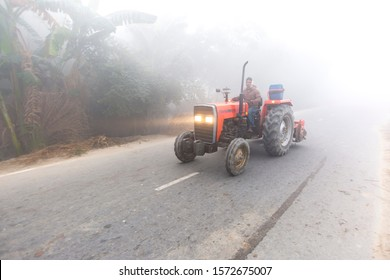 Bangladesh – January 06, 2014: On a foggy winter morning, a tractor is passing through the foggy streets at Ranisankail, Thakurgaon.