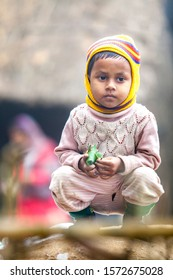 Bangladesh – January 06, 2014: On a foggy winter morning a little kids are wearing winter clothes at Ranisankail, Thakurgaon.