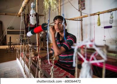 Bangladesh - Mar 03, 2013: Spinning textile