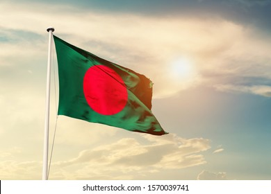 Bangladesh national flag cloth fabric waving on the sky with beautiful sun light - Image