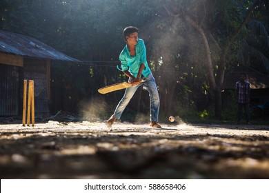 Bangladesh - Oct 08, 2013: Boys playing cricket