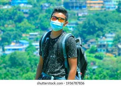 Bangladesh, Sylhet, Jaflong - September 02, 2020. It is a travel Photo. He was wearing a black T-shirt, surgical mask, and sunglasses. a very beautiful moment and this Image is very clear and sharp.