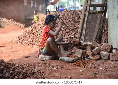 A Bangladeshi Child break bricks at Demra brick breaking yard in Dhaka, Bangladesh, On May 13, 2017. With over half of the population living below the poverty line, women and children are often forced