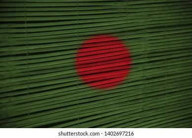 Bangladeshi national flag textures painted on a bamboo surface