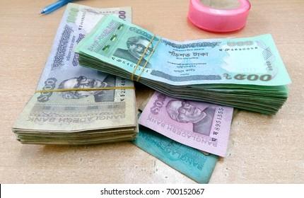 Bangladeshi taka bills isolated over white background