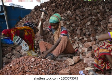 Bangladeshi women break bricks at Demra brick breaking yard in Dhaka, Bangladesh, On May 13, 2017. With over half of the population living below the poverty line, women and children are often forced