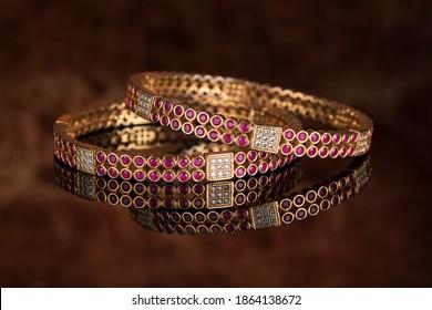 Bangle, Indian bracelets isolated on thedark background - Shutterstock ID 1864138672