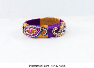 Bangles this bangles are hand made and very colourful. decorated with lace and cloth. in hand it looks very beautiful to women. - Shutterstock ID 1943773255