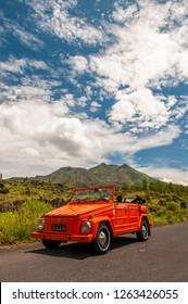 Bangli, Bali / Indonesia : February 27, 2012 : An orange volkswagen Thing 181 on main road of Batur Mountain.