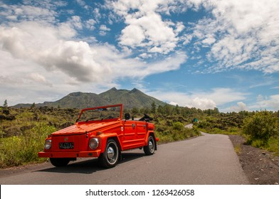 Bangli, Bali / Indonesia : February 27, 2012 : An orange volkswagen Thing 181 on main road of Batur Mountain.