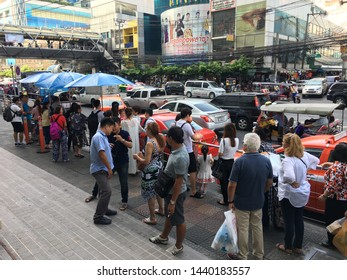 BANGOK - DECEMBER 12, 2017: Many people wait at a stop by Platinum Fashion mall. It is a100 million euro shopping mall which specializes in fashion clothes and accessories retail and wholesale.