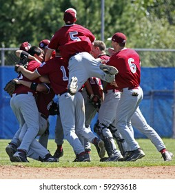 BANGOR, MAINE - AUGUST 15: Members of Maine District 3 celebrate their game-ending out against Canada at the 2010 Senior League Baseball World Series on August 15, 2010 in Bangor, Maine.
