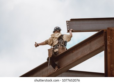 Bangor, Maine / USA - 4-21-2018: US Steel Worker Giving Thumbs Up to Crane Operator on CIANBRO Work Site