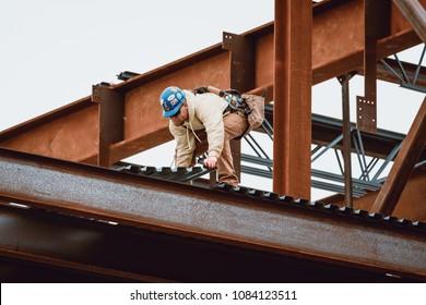 Bangor, Maine / USA - 5-04-2018: US Steel Worker Placing Metal Sheet on CIANBRO Work Site