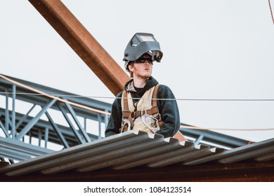 Bangor, Maine / USA - 5-04-2018: US Steel Worker Observing on CIANBRO Work Site