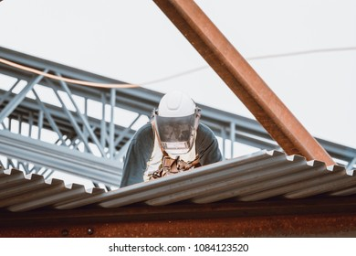Bangor, Maine / USA - 5-04-2018: US Steel Worker Welding on CIANBRO Work Site