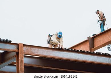 Bangor, Maine / USA - 5-04-2018: US Steel Worker Measuring on CIANBRO Work Site