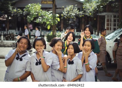 BANGPROK PATHUMTANI THAILAND AUGUST 2017 : Unidentified two school girl take photobomb on 10 August 2017 in Bangprok Pathumtani Thailand.