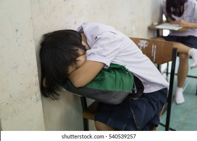 BANGPROK PATHUMTANI THAILAND DECEMBER 2016 : Unidentified student is deep sleep on December 20 2016 in Bangprok Pathumtani Thailand.
