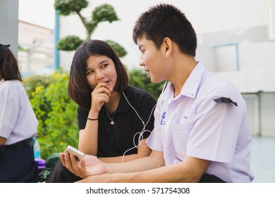 BANGPROK PATHUMTANI THAILAND FEBRUARY 2017 : Unidentified students look smartphone screen on  February 3 2017 in Bangprok Pathumtani Thailand.